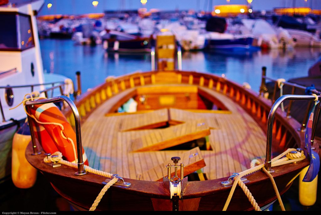 Boat in the night at harbour of Anzio